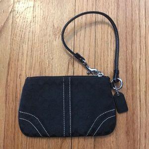 Black fabric coach wristlet